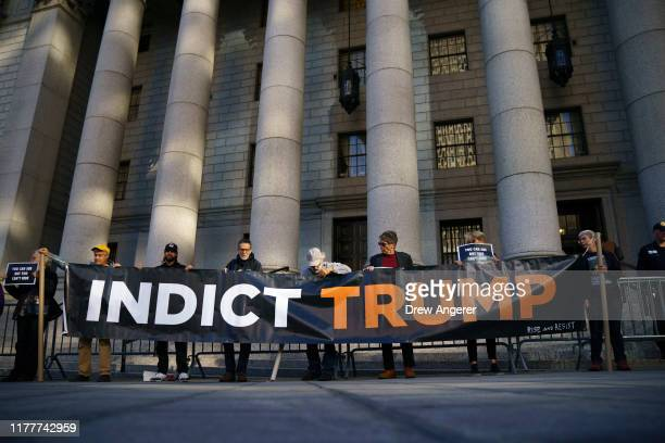 Activists protest outside federal court during a hearing related to President Donald Trump's financial records on October 23 2019 in New York City...