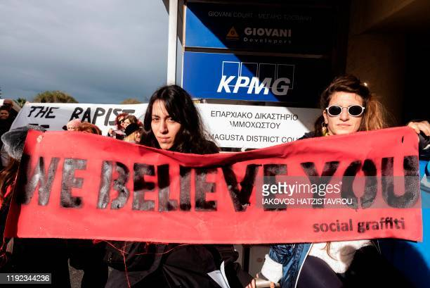 Activists protest outside the Famagusta District Court in support of a British teenager, convicted of falsely accusing a group of Israelis of...