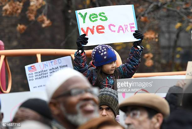 Activists protest racism and hate after swastikas were found in Adam Yauch Park in Brooklyn New York on November 20 2016 / AFP / ANGELA WEISS