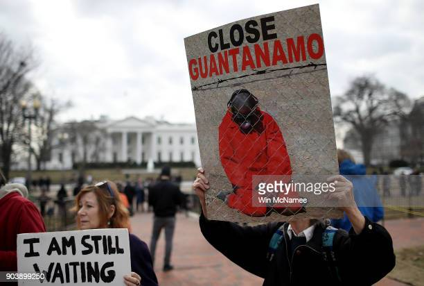 Activists protest the continued operation of the Guantanamo Bay detention camp in front of the White House January 11 2018 in Washington DC Today...