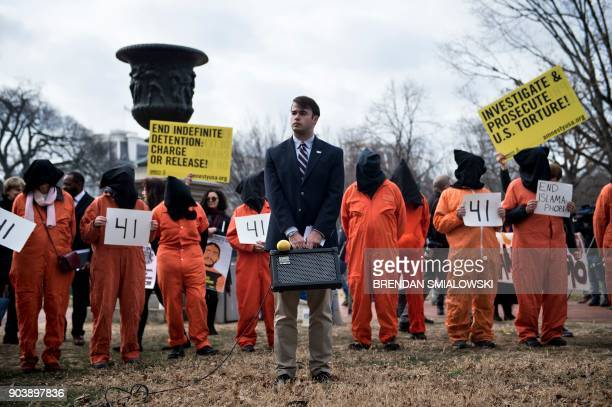 TOPSHOT Activists protest the Guantanamo Bay detention camp during a rally in Lafayette Square outside the White House January 11 2018 in Washington...