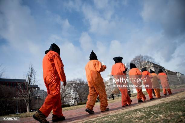Activists protest the Guantanamo Bay detention camp during a rally in Lafayette Square outside the White House January 11 2018 in Washington DC / AFP...
