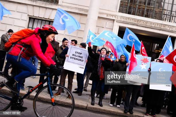 Activists protest the treatment of Uyghur Muslims by Chinese authorities in the East Turkestan region of China's Xinjiang province at a protest...