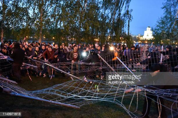 Activists protesting against a plan to build an Orthodox cathedral clash with antiriot police and security guards at a construction site in a park in...