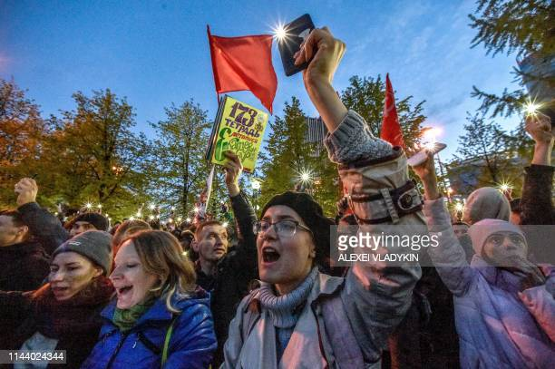 Activists protesting against a plan to build an Orthodox cathedral rally at a construction site in a park in the Russian Urals city of Yekaterinburg...