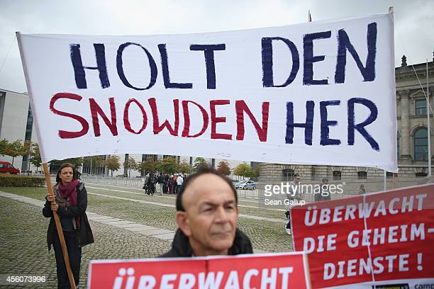 Activists protesting for more information about the cooperation between the US National Security Agency and the German federal intelligence service...