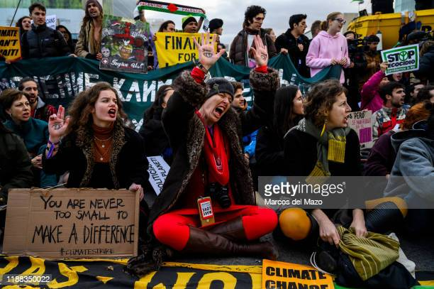 Activists protesting outside IFEMA where UN Climate Change Conference COP25 is being held Fridays for Future and Extinction Rebellion activists are...