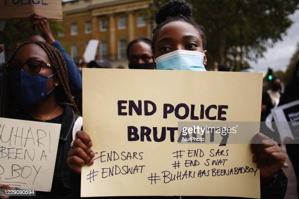 Activists protesting police brutality by the Nigerian Special Anti-Robbery Squad demonstrate on Whitehall in London, England, on October 15, 2020....