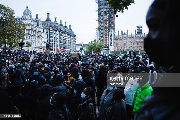 Activists protesting police brutality by the Nigerian Special Anti-Robbery Squad demonstrate in Parliament Square in London, England, on October 21,...