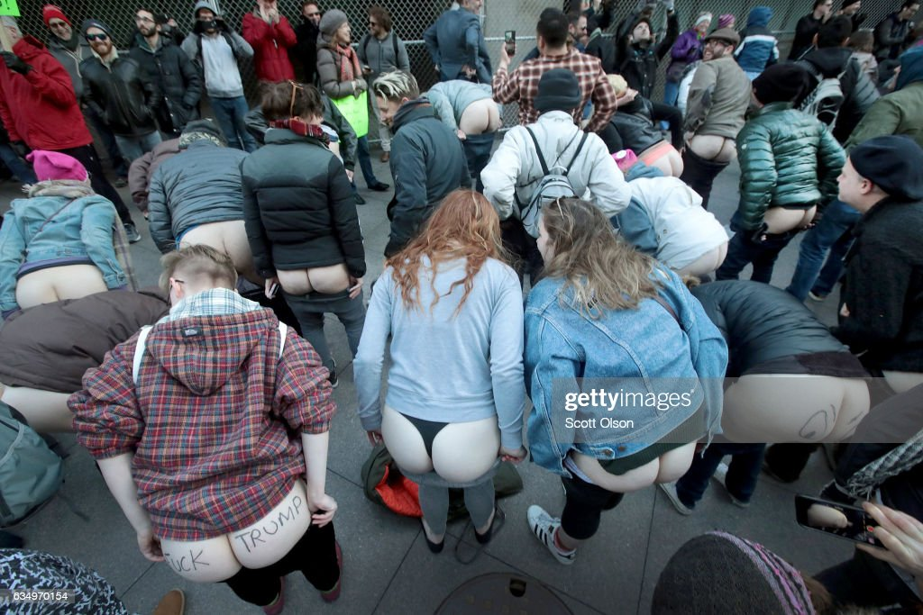 """Anti-Trump """"Mass Mooning"""" Held In Front Of Trump Tower In Chicago : News Photo"""