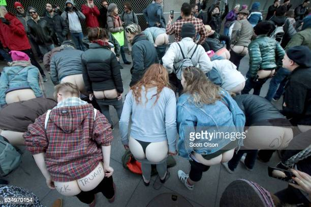 Activists pull down their pants and moon Trump Tower on February 12 2017 in Chicago Illinois The event was staged to protest the policies of...