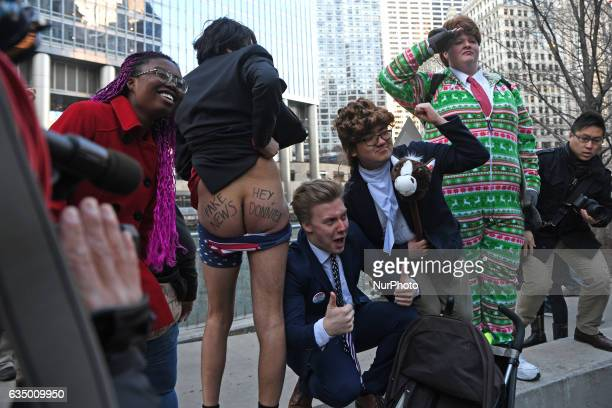 Image contains nudity Activists pull down their pants and moon Trump Tower on February 12 2017 in Chicago Illinois The event was staged to protest...