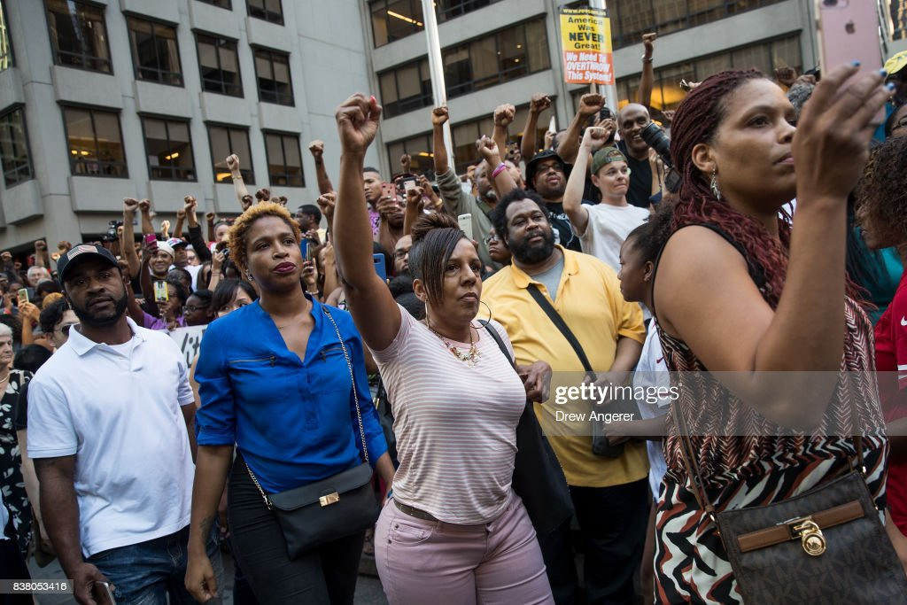 Activists raise their fists as they rally in support of NFL quarterback Colin Kaepernick outside the offices of the National Football League on Park Avenue, August 23, 2017 in New York City. During the NFL season last year, Kaepernick caused controversy by kneeling during the National Anthem at games to protest racial oppression and police brutality. Kaepernick is currently a free agent and some critics and analysts claim NFL teams don't want to sign him due to his public display of his political beliefs.