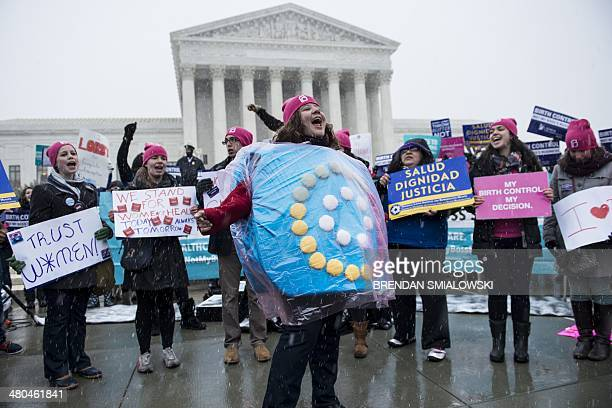 Activists rally against Hobby Lobby's choice to deny contraceptive healthcare coverage to its employees outside the Supreme Court March 25 2014 in...