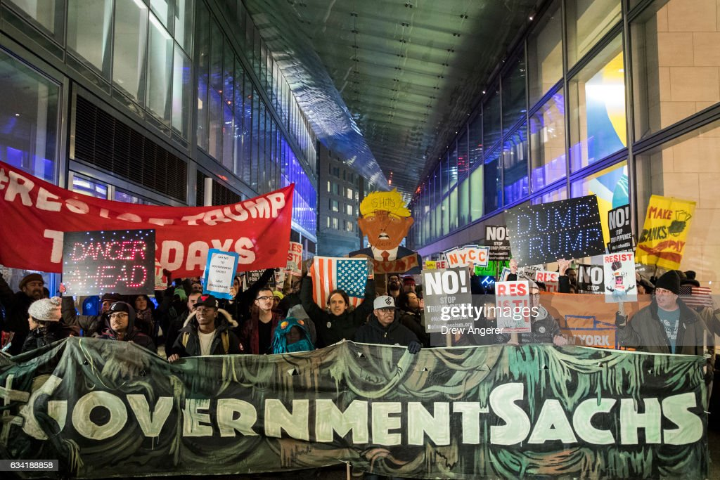 Activists rally against President Donald Trump's reported plans to loosen Wall Street Regulations and repeal the Dodd-Frank Act outside of Goldman Sachs headquarters in Lower Manhattan, February 7, 2017 in New York City. The Dodd-Frank Wall Street Reform and Consumer Protection Act was signed into law by President Barack Obama in July 2010 in response to the financial crisis of 2007-2008.