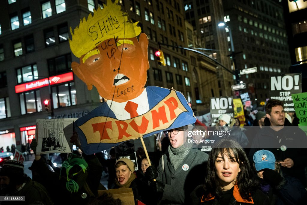 Activists rally against President Donald Trump's reported plans to loosen Wall Street Regulations and repeal the Dodd-Frank Act as they march toward Goldman Sachs headquarters in Lower Manhattan, February 7, 2017 in New York City. The Dodd-Frank Wall Street Reform and Consumer Protection Act was signed into law by President Barack Obama in July 2010 in response to the financial crisis of 2007-2008.