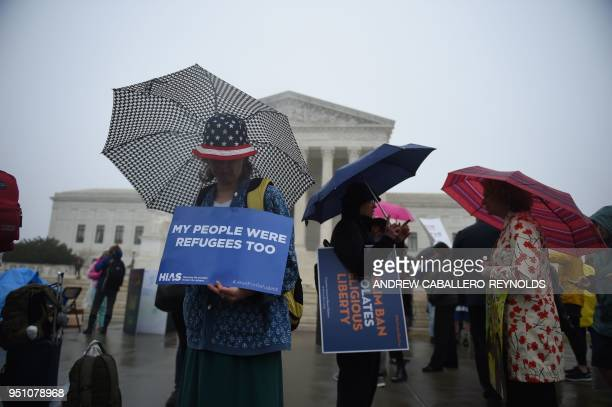 TOPSHOT Activists rally against the Muslim Ban on the day the Supreme Court hears arguments in Hawaii v Trump in front of the court in Washington DC...