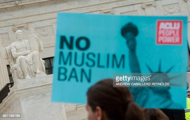 Activists rally against the Muslim Ban on the day the Supreme Court hears arguments in Hawaii v Trump in front of the court in Washington DC on April...