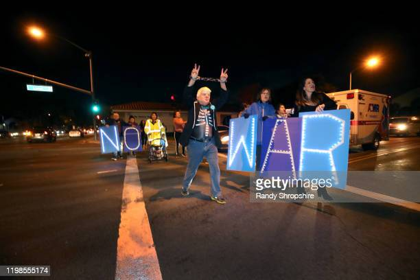 Activists rally at the intersection of 14th Street and Lime for No War in Iran on January 09 2020 in Riverside California