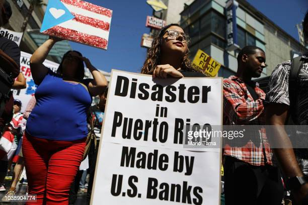 Activists rally calling for support of Puerto Rico one year after Hurricane Maria devastated the island on September 23 2018 in Los Angeles...