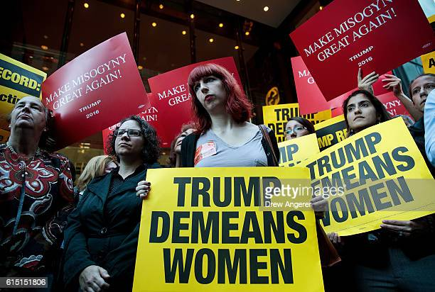 Activists rally during a protest against Republican presidential candidate Donald Trump for his 'treatment of women' in front of Trump Tower on...