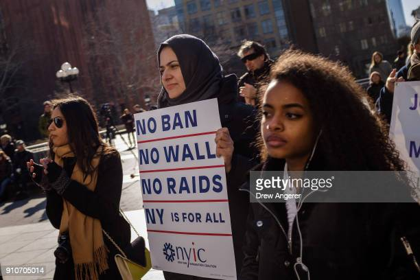 Activists rally during a protest to the mark the one year anniversary of the Trump administration's executive order banning travel into the United...