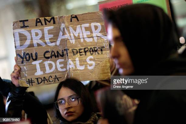 Activists rally for the passage of a clean Dream Act one without additional security or enforcement measures outside the New York office of Sen Chuck...