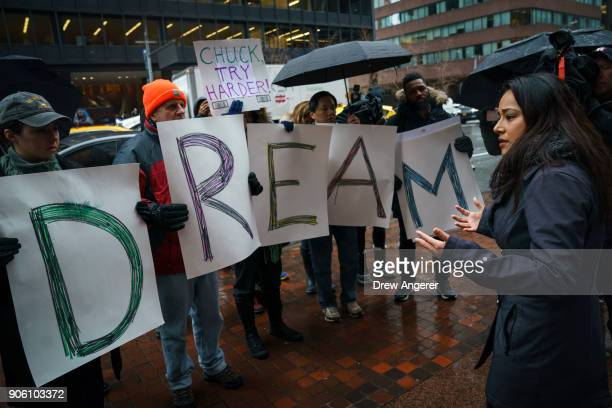 Activists rally for the passage of a 'clean' Dream Act one without additional security or enforcement measures outside the New York office of Sen...