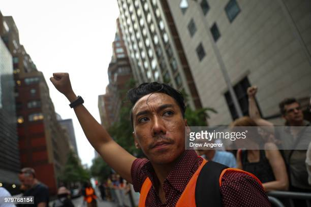 Activists rally in support immigrants and to mark World Refugee Day June 20 2018 near the United Nations in New York City Bowing to political...