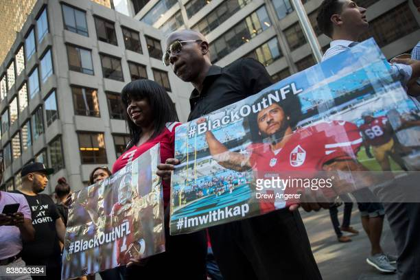Activists rally in support of NFL quarterback Colin Kaepernick outside the offices of the National Football League on Park Avenue August 23 2017 in...
