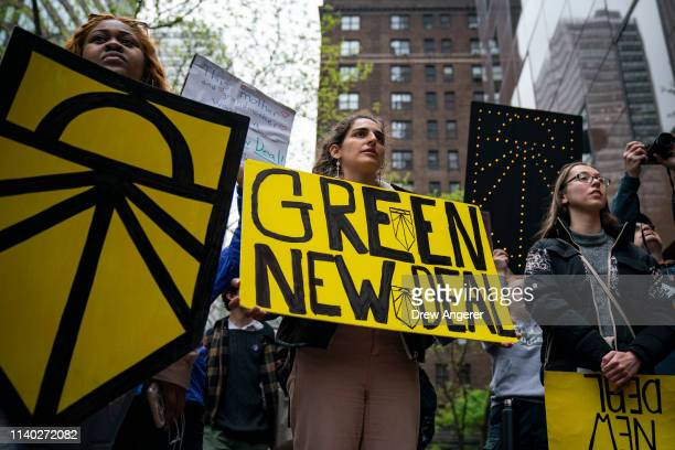 Activists rally in support of proposed 'Green New Deal' legislation outside of Senate Minority Leader Chuck Schumer's New York City office April 30...