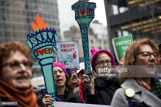 Activists rally in support of the Environmental Protection Agency outside of Senate Minority Leader Chuck Schumer's Midtown Manhattan office April 4...