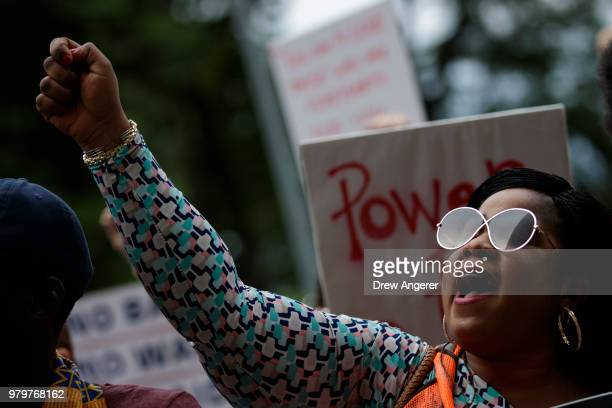 Activists rally outside of Trump World Tower to support immigrants and to mark World Refugee Day June 20 2018 in New York City Bowing to political...
