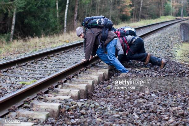 Activists remove ballast from between the railway sleepers on the track that will be used to transport nuclear waste on November 25 2011 in Leitstade...