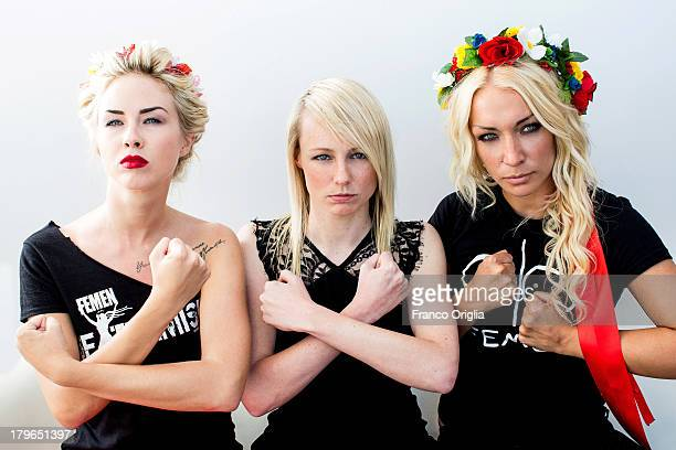 Activists Sasha Shevchenko and Inna Shevchenko pose with director Kitty Green during the 'Femen' Portrait Session for the film 'Ukraine Is Not A...