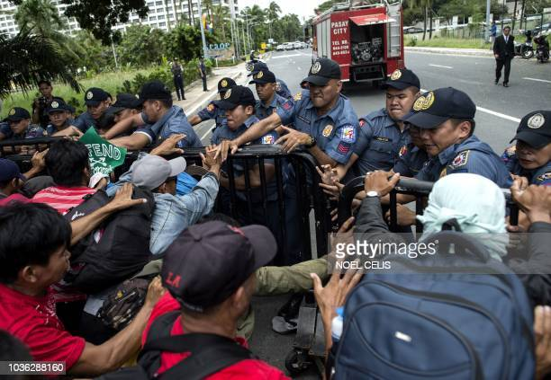 Activists scuffle with police during an antimining protest near the Sofitel Hotel where the International Conference of the Chamber of Mines of the...