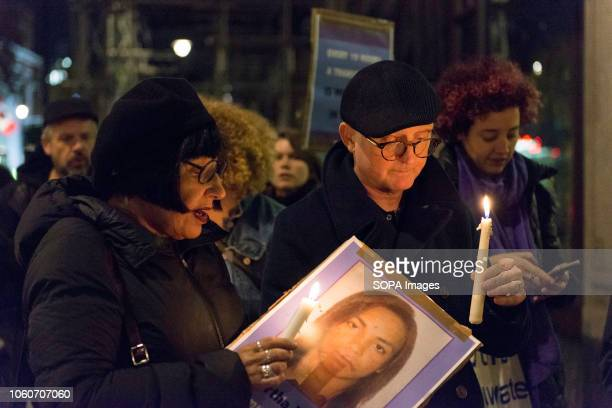 Activists seen carrying placards and candles during the vigil Activists from Brazilian Women Against Fascism UK gathered outside the Brazilian...