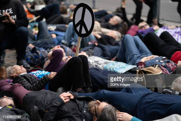 Activists seen lying outside Westminster Abbey during the Thanksgiving service for the Navy. Anti-nuclear protests outside of Westminster Abbey...