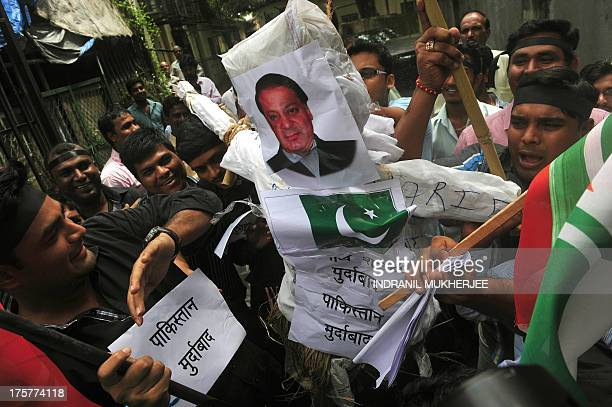 Activists shout antiPakistan slogans as they prepare to burn an effigy of Pakistani Prime Minister Nawaz Sharif during a protest against the killing...