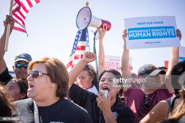"""Activists shout chants during the """"End Family Detention,"""" event held at the Tornillo Port of Entry in Tornillo, Texas on June 24, 2018. - Texas is at..."""
