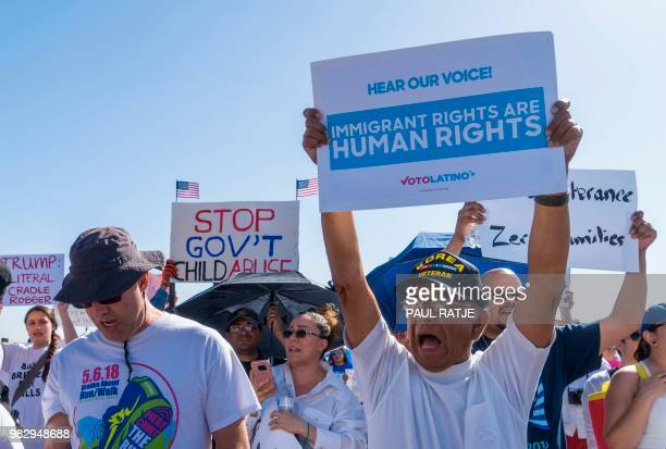 Activists shout chants during the 'End Family Detention' event held at the Tornillo Port of Entry in Tornillo Texas on June 24 2018 Texas is at the...