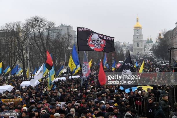 Activists shout slogans during a mass march and rally calling for the impeachment of Ukrainian president Petro Poroshenko organized by 'Movement Of...