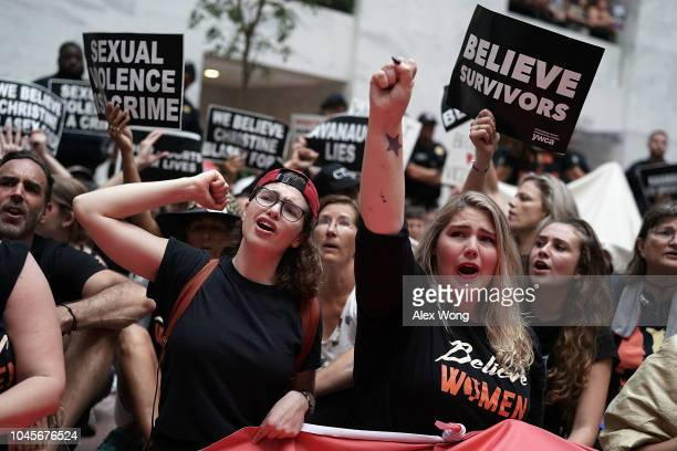 Activists shout slogans during a protest October 4 2018 at the Hart Senate Office Building on Capitol Hill in Washington DC Activists are rallying in...