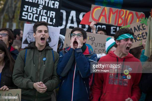 Activists shout slogans during the demonstration. Thousands of people from all over Europe protest in Madrid against COP25, climate change and to...