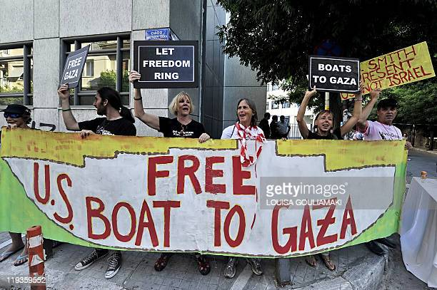 US activists shout slogans near the residence of the US ambassador to Greece on July 7 demanding his intervention to help 'free' the US boat part of...