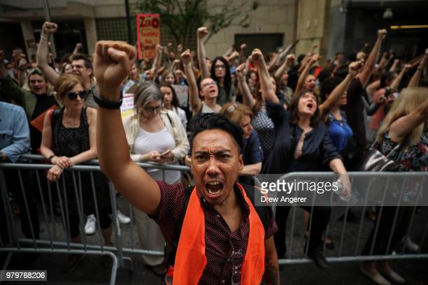 Activists shout toward the US Mission to the United Nations while rallying in support immigrants and to mark World Refugee Day June 20 2018 in New...