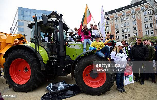 Activists sit aboard a tractor during a protest by European farmers blocking access to the European institutions in Brussels September 7 2015 Angry...