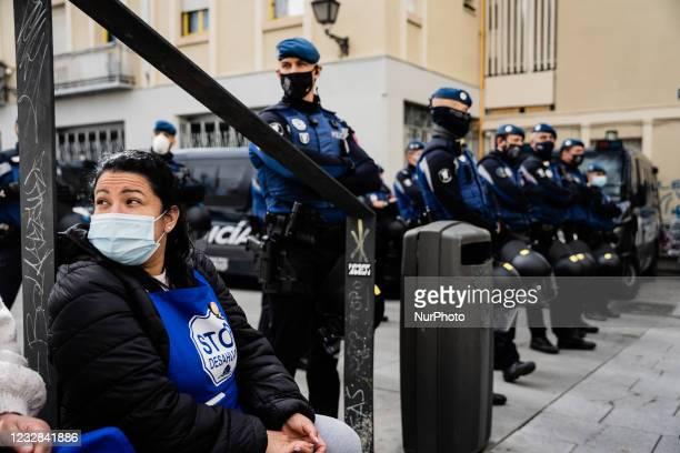 Activists sitting on a curb protests next to the police coordinator that surrounds the building where the EMVS house is located where the eviction is...