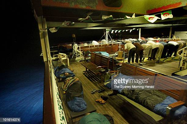 Activists sleep and pray on the Turkish passenger ship Mavi Marmara part of the Freedom Flotilla carrying 600 activists bound for Gaza on May 29 2010...