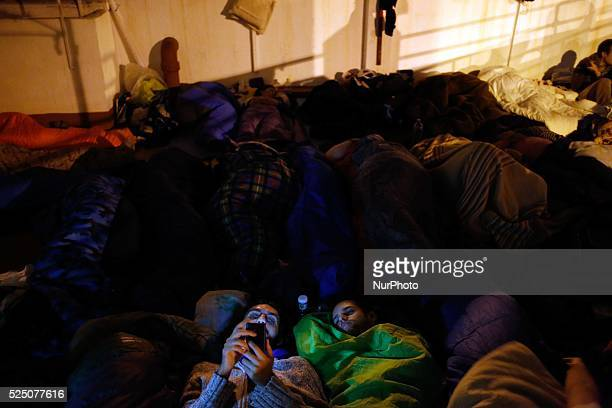 Activists sleep during the permanent camping in Ofelia Nieto 29 building in tetuan Madrid others check thair mobile phones Hundreds of activists and...